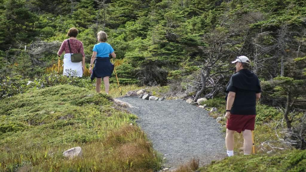 People walking on gravel trail in Louisbourg Nova Scotia, Canada