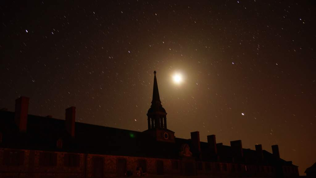 Star gazing under a full moon at the Fortress of Louisbourg National Historic Site, Nova Scotia, Canada